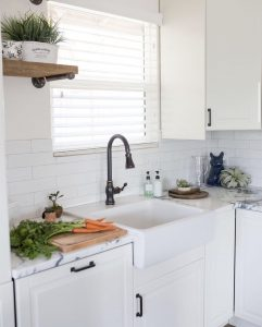 Treat your kitchen window to one of to the most popular window treatments available the classic wood blinds or faux wood blinds Photo credit @sonorandesertliving