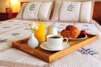 bed linens with breakfast in bed