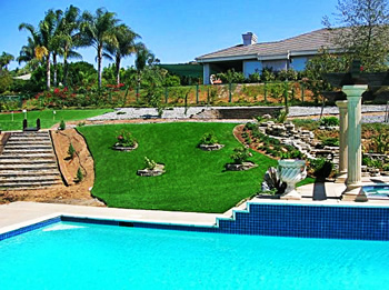 synthetic lawn surrounding residential pool