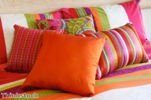 A collection of pillows can be an alternative to a traditional headboard.