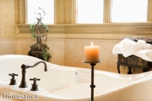 Several elements can create a vintage look in a bathroom.