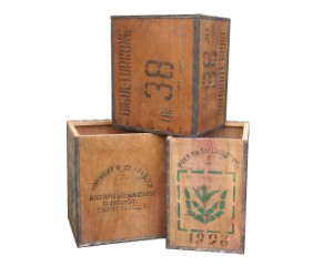 Vintage wooden boxes are among the many containers that homeowners can use to store things attractively.