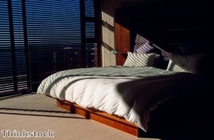 Blackout shades can prevent light from seeping into a bedroom and disturbing one's sleep.