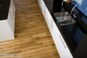 Rugs soften the look of kitchens with wood flooring.