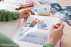 Choosing family photos for a display should take into account the image size and frame color to create a unified collection.
