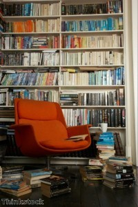 Bookcase space can be split between open shelving and hidden storage.