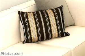 Cushions in neutral, but interesting patterns can revive the look of upholstered furniture.