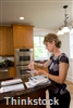 Installing a kitchen desk gives homeowners a comfortable place to take care of bill-paying and other paperwork.